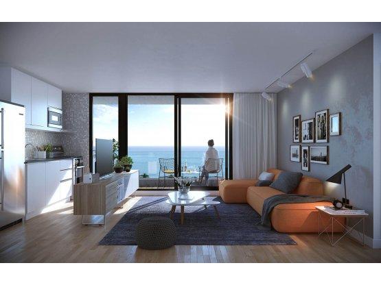 TEMPO.Dos dormitorios a metros del mar.U$S350.000